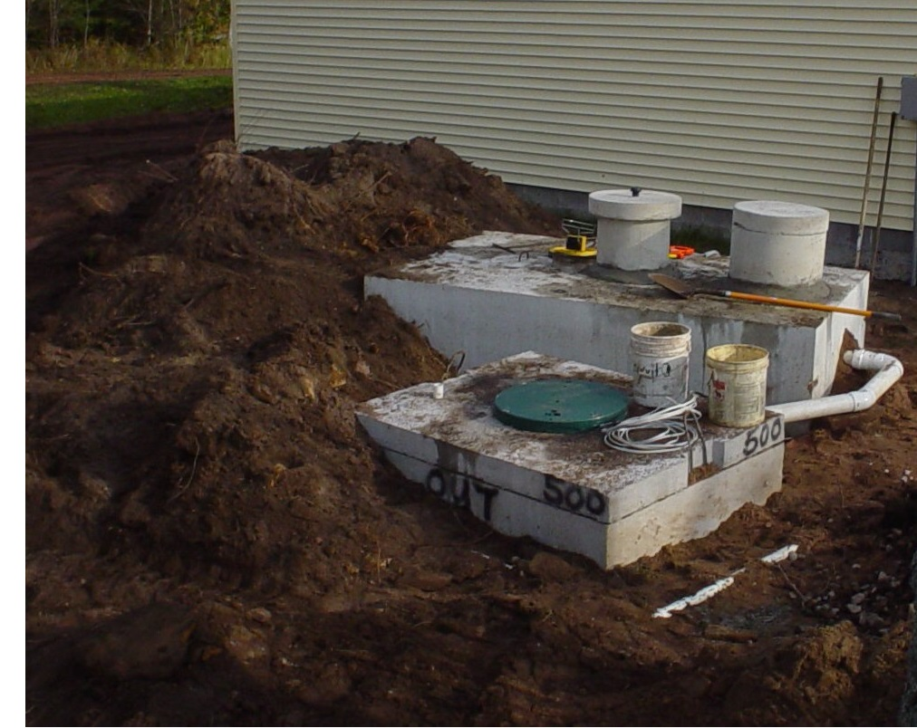 Photo depicting a new septic system installed on a residential property.