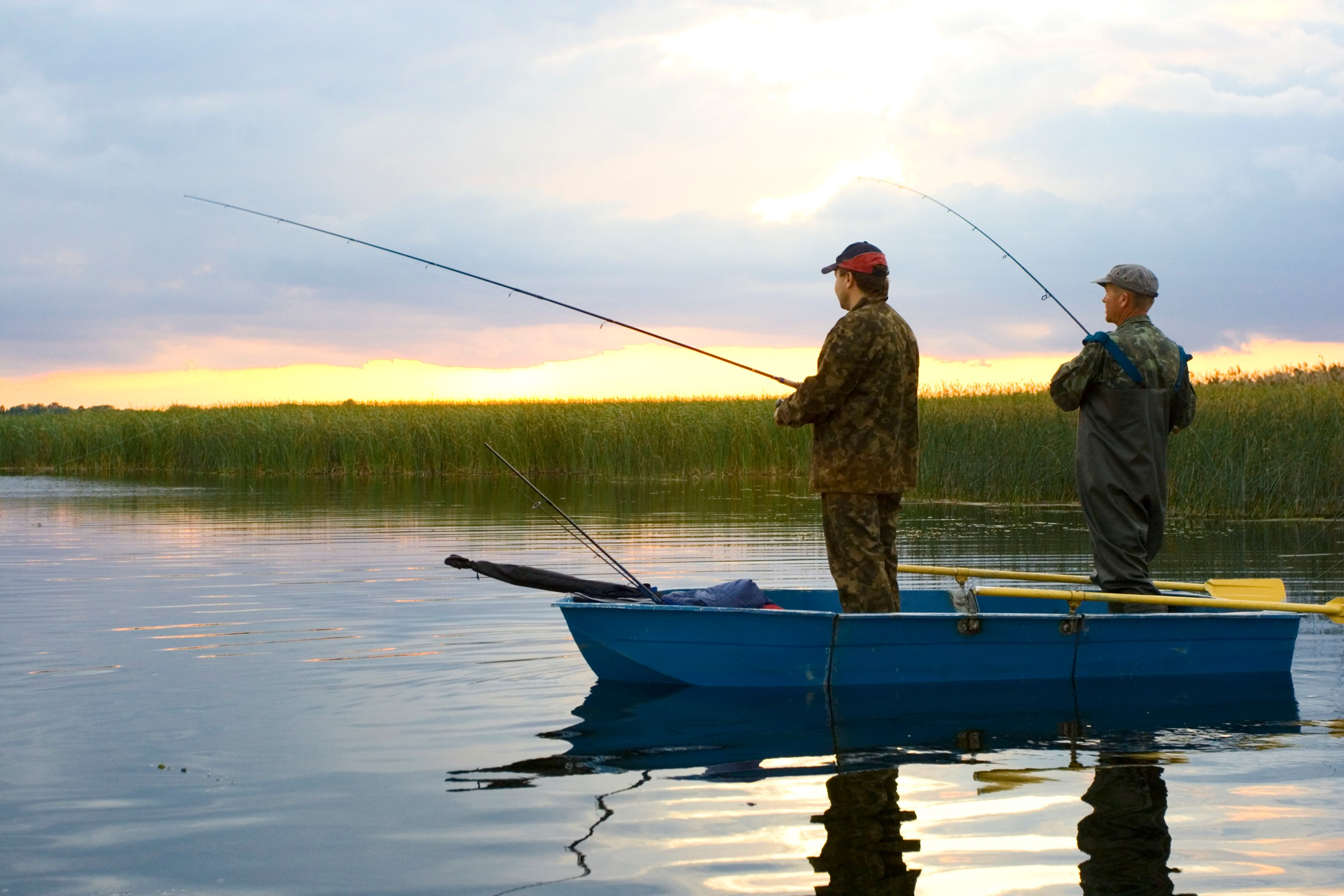 Fishermen casting lines at dusk.  Eating fish is one of the most common ways we're exposed to mercury.