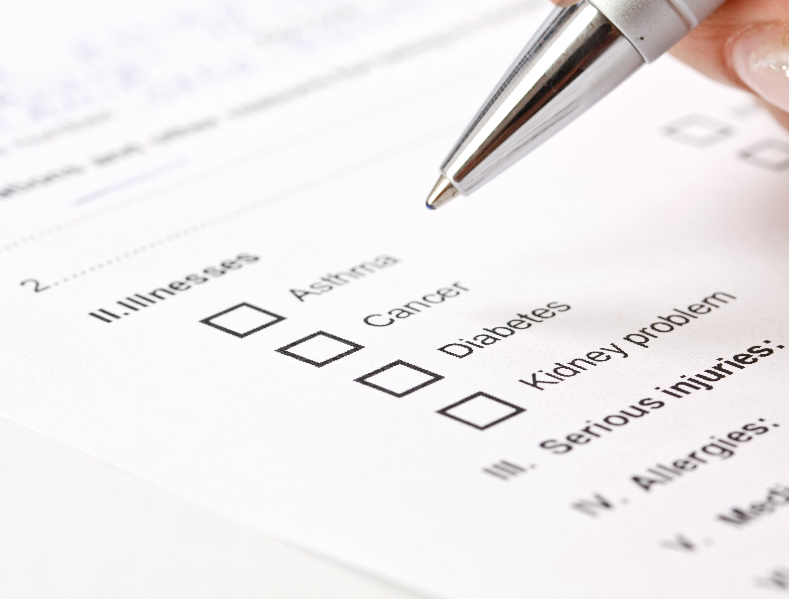 Close up photo of a medical history questionnaire