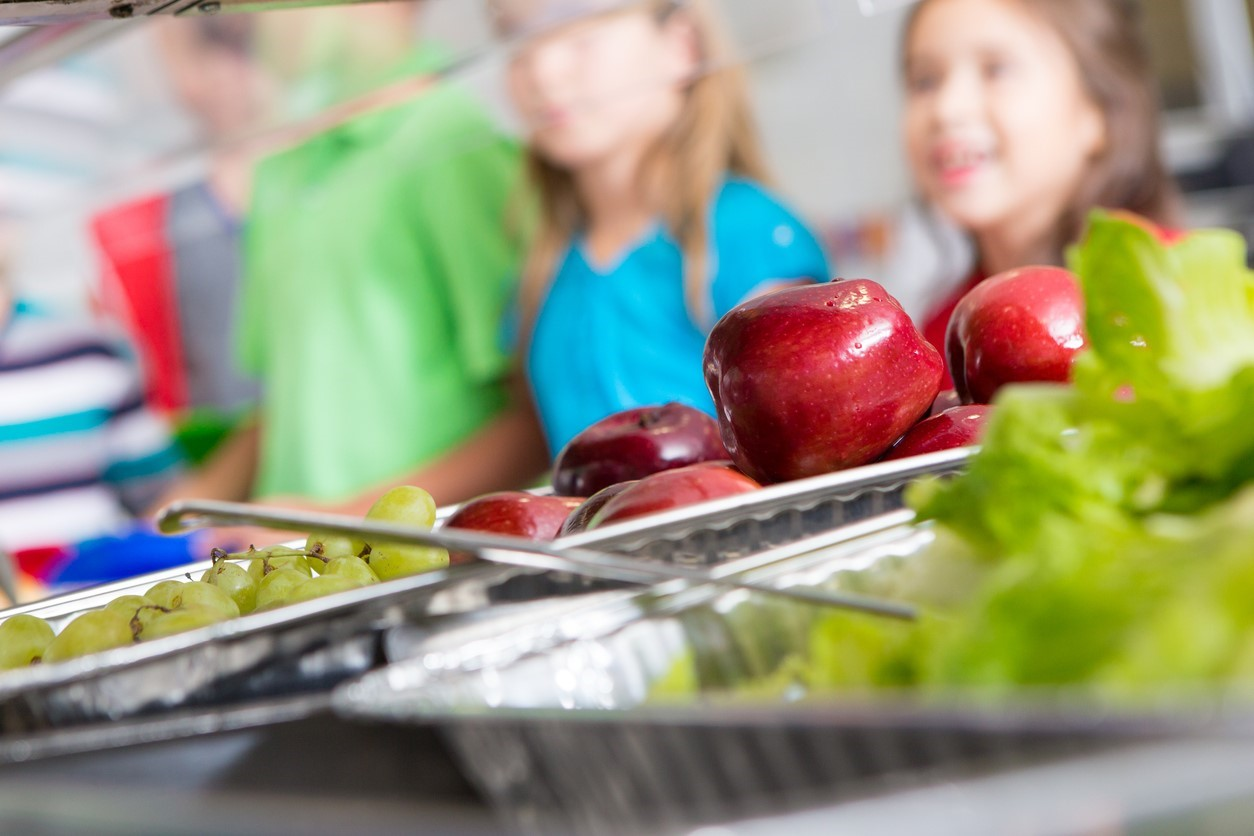 Closeup of healthy food in a school cafeteria lunch line.