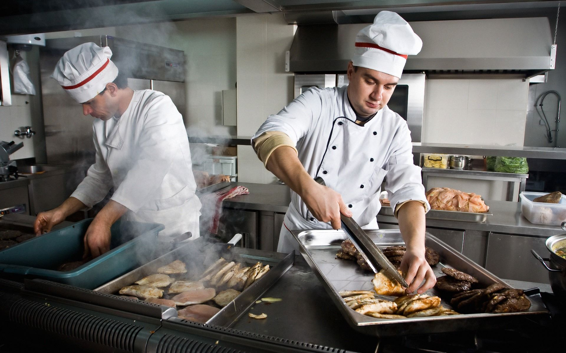Chefs working in a kitchen preparing food
